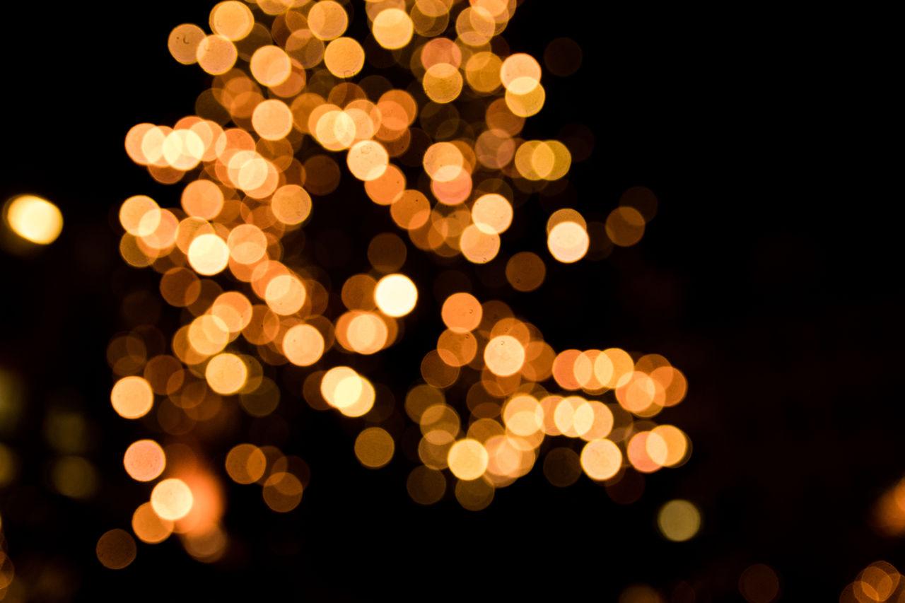 night, illuminated, defocused, christmas, no people, celebration, christmas decoration, black background, close-up, outdoors