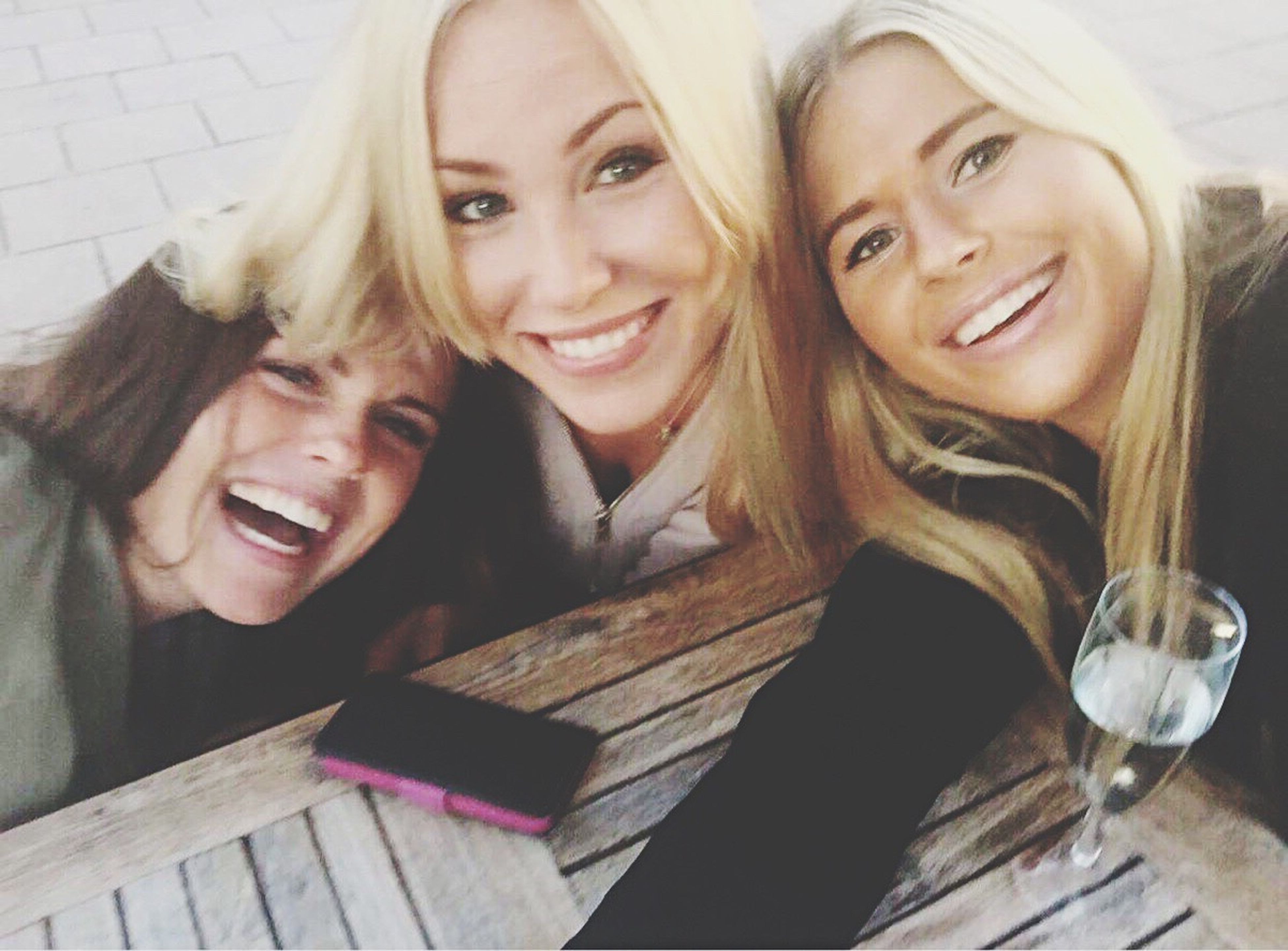 looking at camera, portrait, smiling, happiness, togetherness, toothy smile, real people, cheerful, headshot, two people, bonding, blond hair, enjoyment, friendship, young women, leisure activity, women, young adult, day, indoors, close-up, people, adult