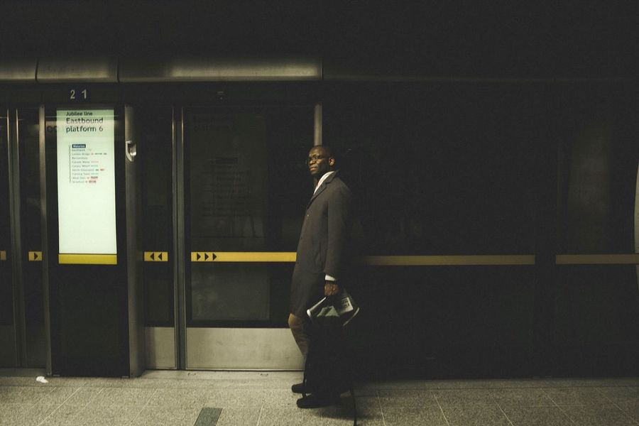 Paint The Town Yellow Real People Full Length One Person Standing Indoors  Men Lifestyles Illuminated Night Well-dressed People Metro Metro Station London Subway The Week On EyeEm Mobility In Mega Cities Colour Your Horizn