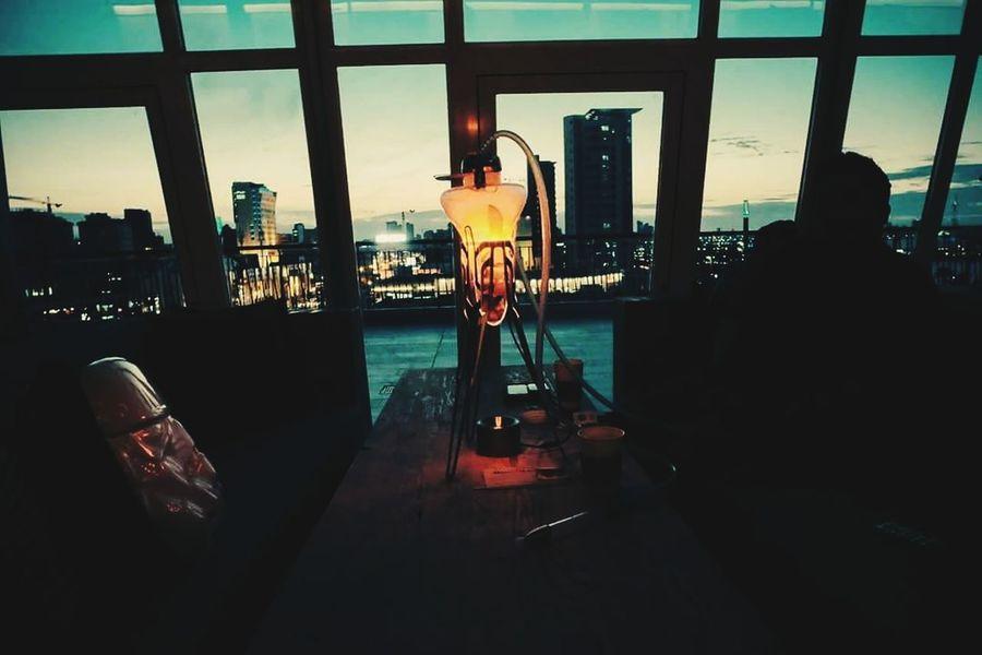 Neon Life Indoors  Window Built Structure Architecture People Cityscape Only Men EyeEmNewHere Photographer Cloud - Sky Urbanlife Architecture Streetstyle Streetleaks Silhouette EyeEm Lights Instamood EyeEm Selects Tagsforlikes Fuji Shisha Shisha Time Hookah