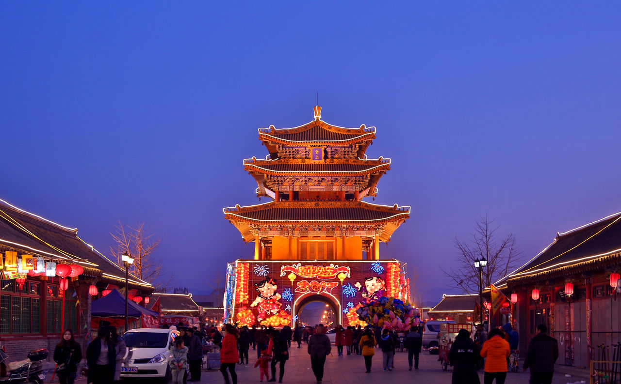 Travel Tourism City Travel Destinations Cultures Business Finance And Industry Architecture Sky Ancient Chinese New Year History Night Chinatown Chinese Lantern Festival Outdoors Sunset People Arrival Building Feature Cityscape Spring Festival Tradition Architecture Illuminated Celebration