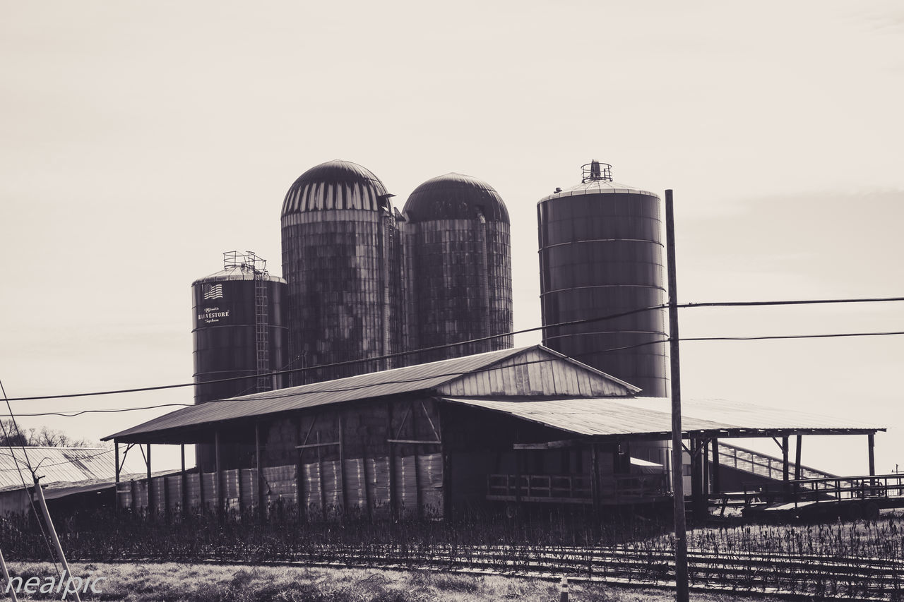 Agricultural Building Agriculture Architecture Built Structure Day Factory Industry Low Angle View No People Outdoors Silo Sky Storage Tank