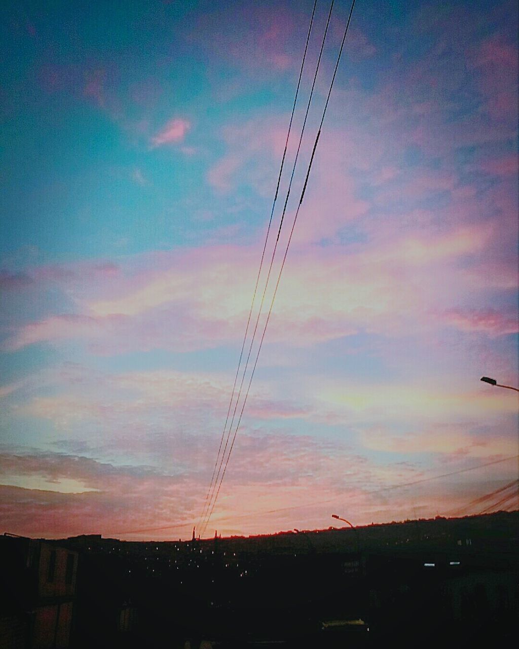 silhouette, sky, sunset, cable, low angle view, no people, connection, cloud - sky, built structure, outdoors, electricity pylon, building exterior, nature, architecture, technology, telephone line, day
