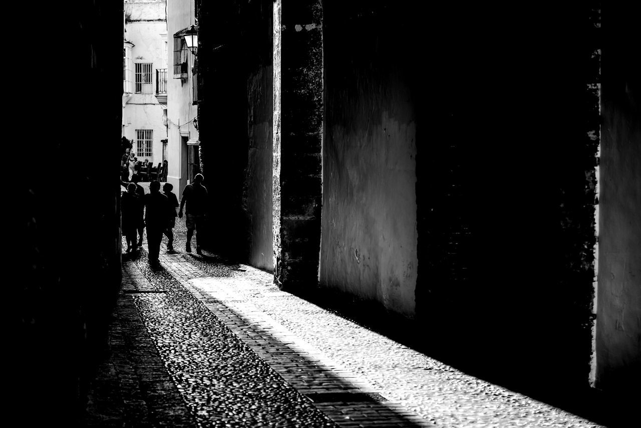 Adult Alley Architecture Black And White Black And White Photography Building Exterior Built Structure BYOPaper! Contrast Day Full Length Men Outdoors People Real People Rear View Shadow Shadows & Lights SPAIN The Great Outdoors - 2017 EyeEm Awards Togetherness Walking Women
