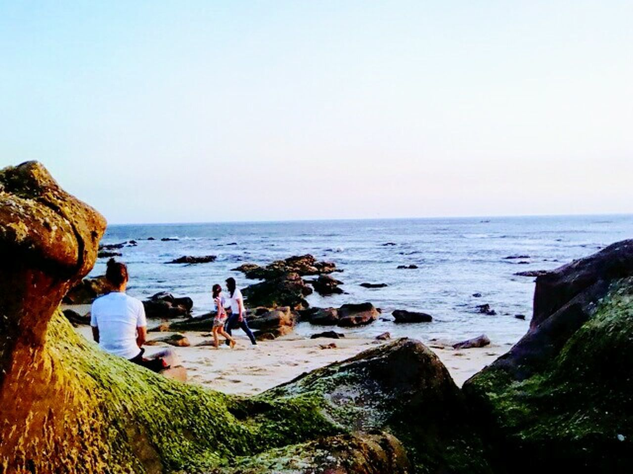 Sea Beach Water Rock - Object Horizon Over Water Nature Men Women Vacations Outdoors Scenics Beauty In Nature Lifestyles Real People Wave Adult Sky Standing People Sand Low Angle View Beachtime The Great Outdoors - 2017 EyeEm Awards EyeEmNewHere Clear Sky