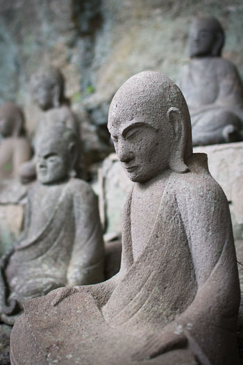 Japan Art And Craft Close-up Creativity Day Focus On Foreground Human Representation Male Likeness No People Nokogiriyama Outdoors Religion Sculpture Spirituality Statue Stone Material