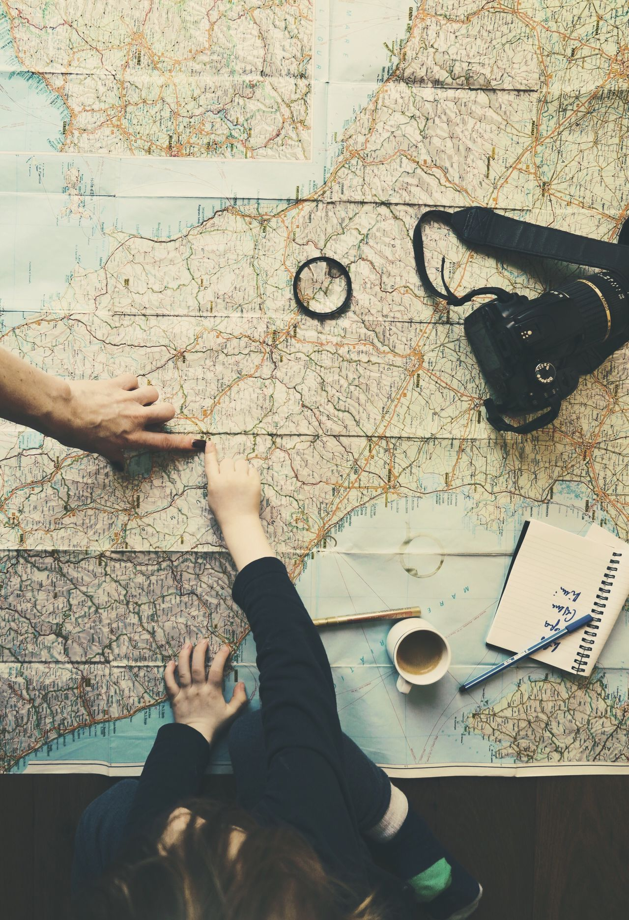 High Angle View Lifestyles Real People Women Human Hand Togetherness Two People Human Body Part People Adult Child Map Travel Travel Destinations Camera Coffee Fingers Showing Family Lens Route Women Around The World Long Goodbye Let's Go. Together.