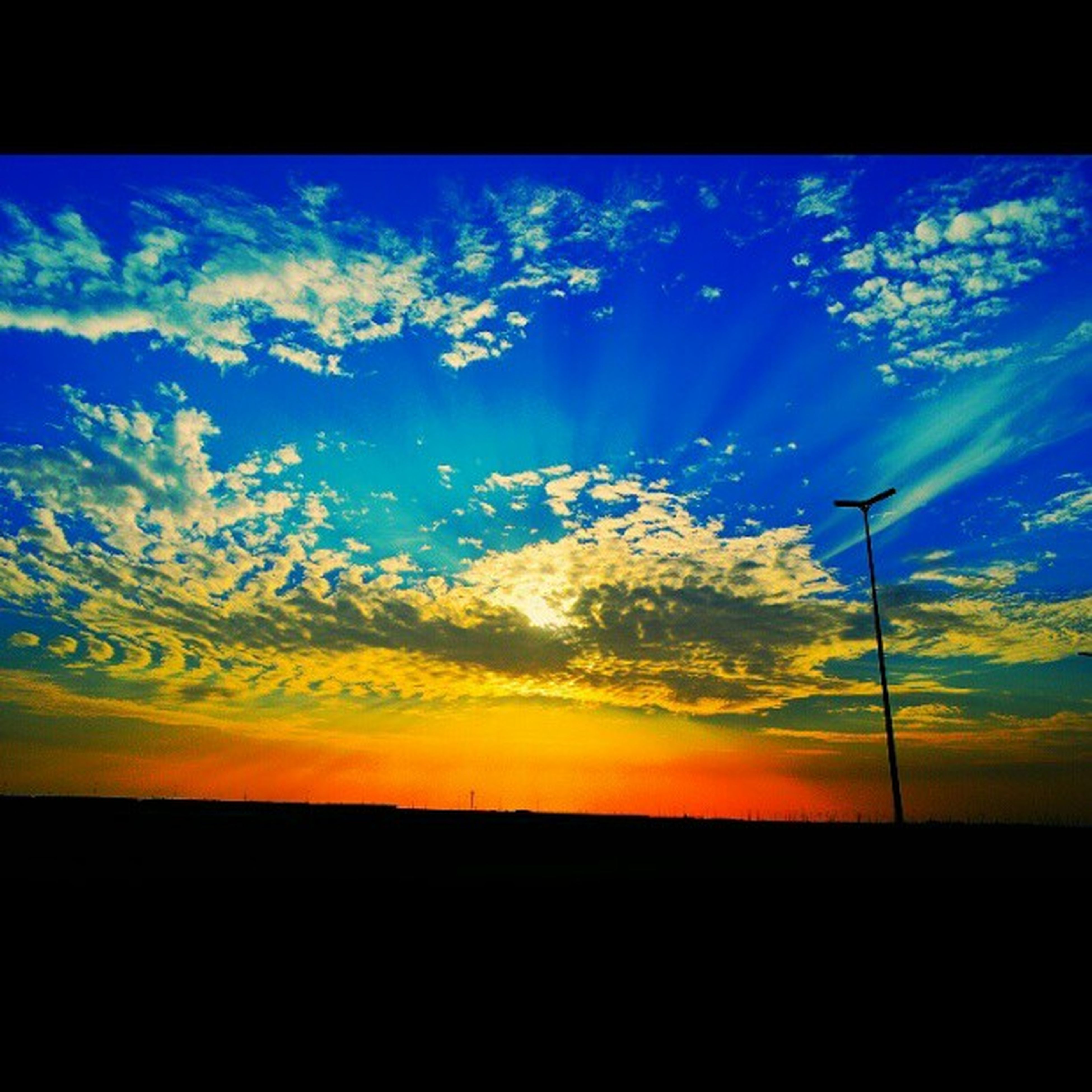 sunset, silhouette, tranquil scene, scenics, sky, beauty in nature, tranquility, landscape, nature, field, blue, idyllic, transfer print, cloud, cloud - sky, orange color, dark, auto post production filter, horizon over land, outdoors