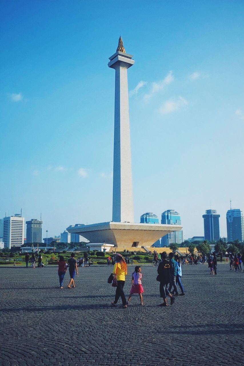 travel destinations, architecture, built structure, tourism, large group of people, tall - high, travel, real people, building exterior, city, day, vacations, history, skyscraper, monument, city life, outdoors, women, sky, low angle view, men, people