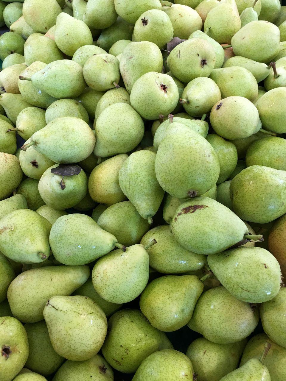 Full Frame Shot Of Pears In Market For Sale