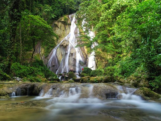 Water Tree Motion Long Exposure Outdoors No People Nature Green Color Waterfall Beauty In Nature Day Vacations Swimming AmbonIsland EyeEm Nature Lover Summer Mountain Tree Beauty In Nature Nature Lifestyles Landscape EyeEmNewHere Perspectives On Nature