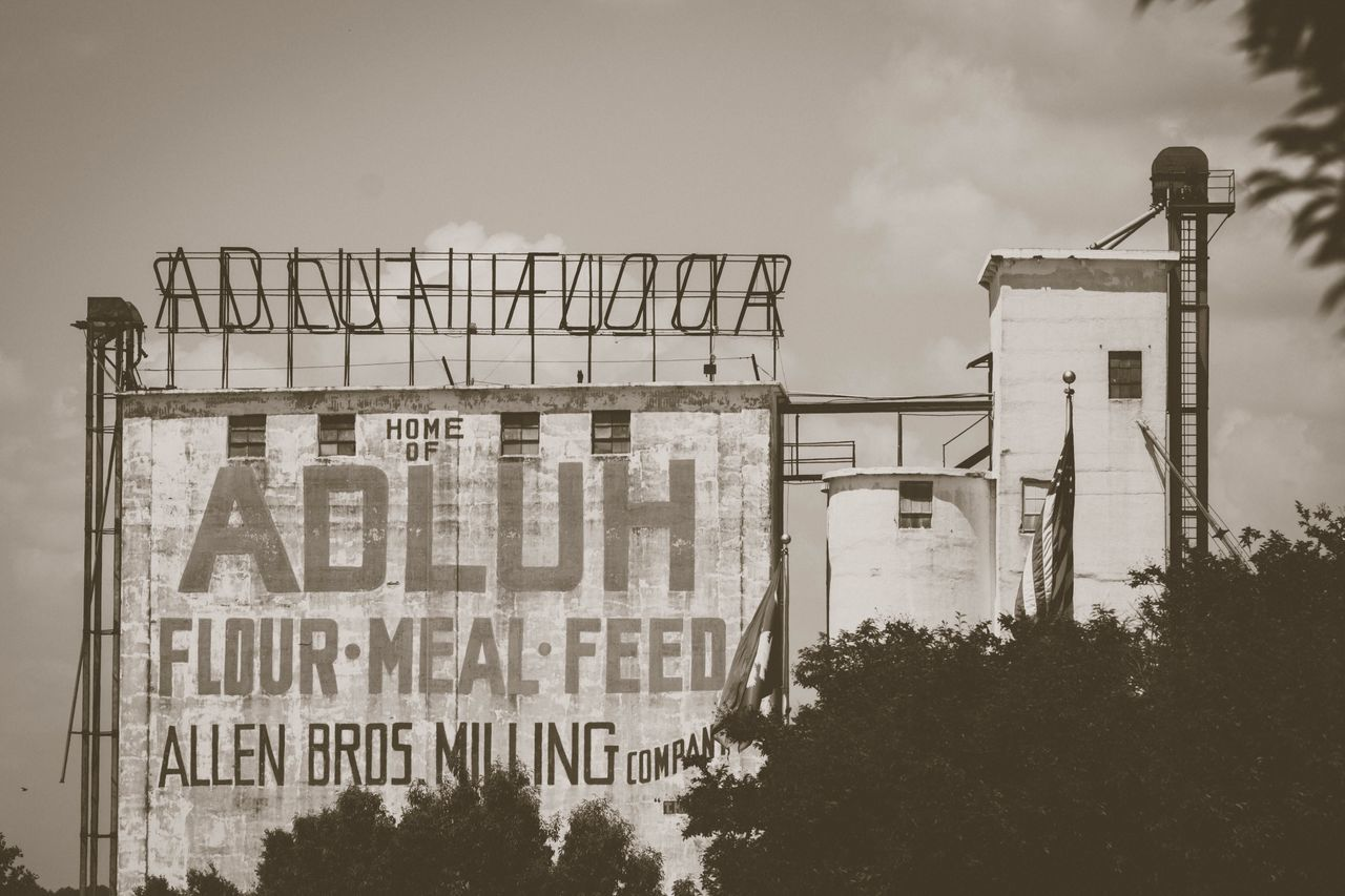 Adluh Flower Mill Text Sky Architecture Communication Built Structure Low Angle View Day No People Outdoors Building Exterior Tree City Urban Blackandwhite Black And White Building Adluh