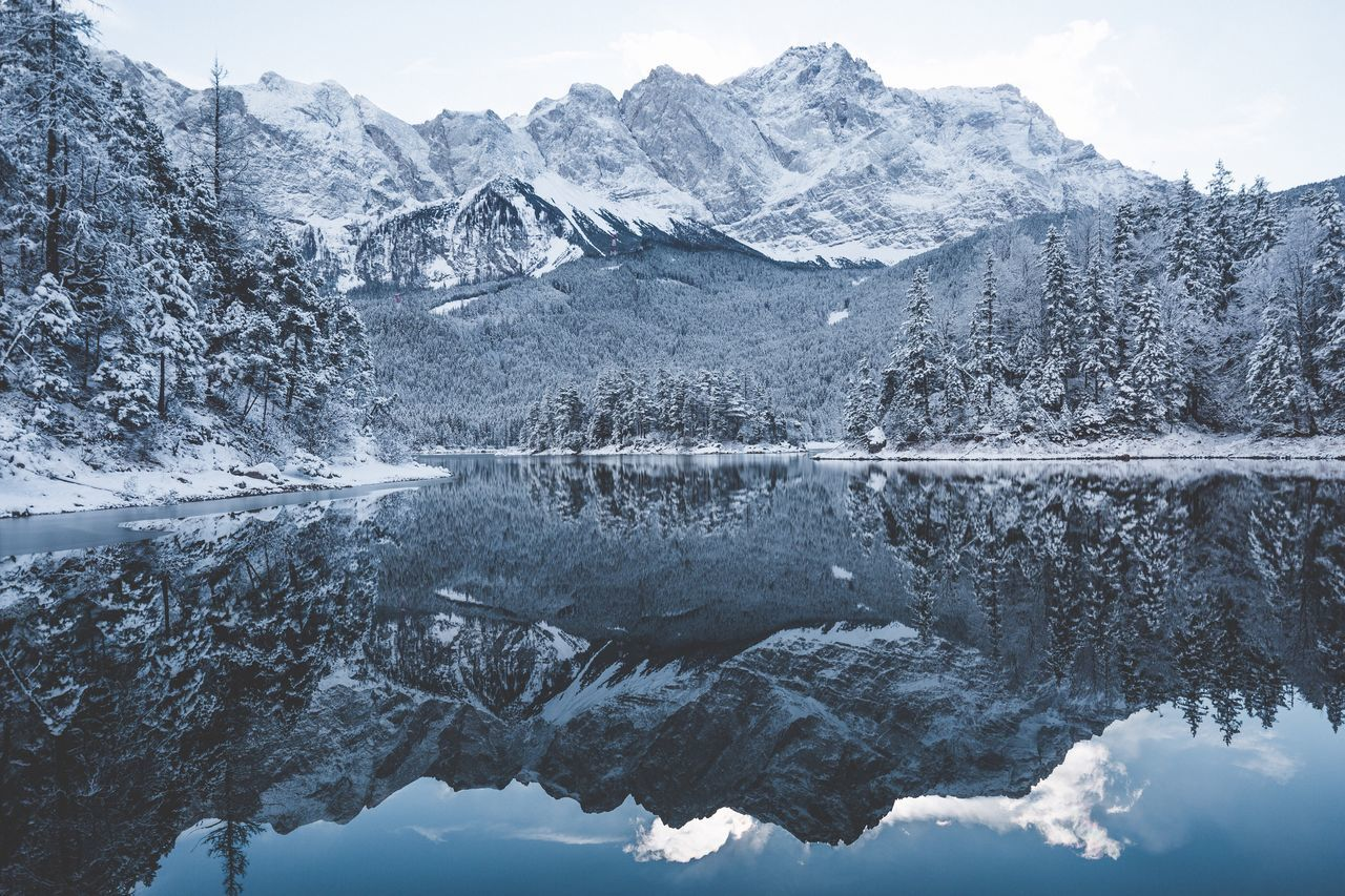 Winter day in the Alps. Eibsee Reflection Mountain Nature Snow Lake Water Tranquility Beauty In Nature Waterfront Scenics Outdoors No People Day Winter Cold Temperature Sky