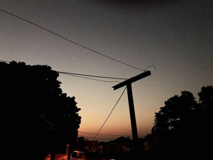 Nightphotography Sunset_collection Sunset Evening Sky Cable Silhouette Tree Connection Low Angle View Power Line  No People Nature Outdoors Technology Sky Clear Sky Beauty In Nature Day EyeEm Ready