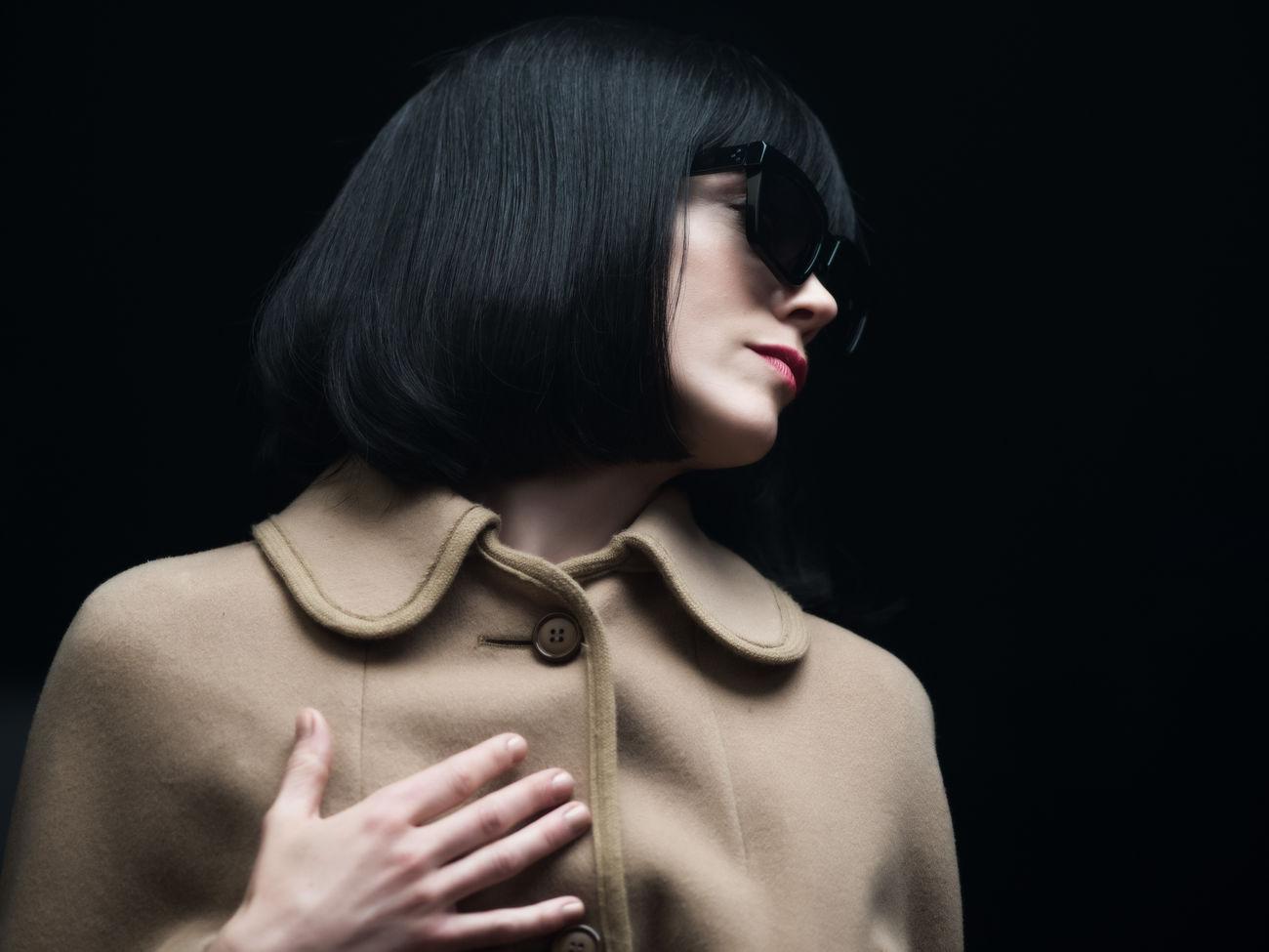Portrait of Ane Dahl Torp. Ane Dahl Torp Black Background Brown Coat Close-up Film Noir One Person Portrait Sunglasses Wig