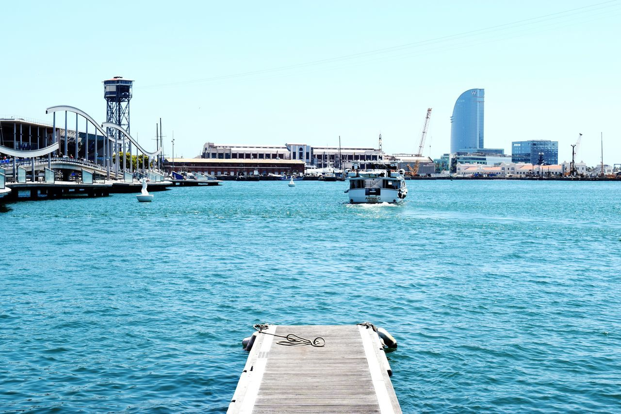 Barcelona Port Nautical Vessel Transportation Harbor Mode Of Transport Architecture Water Built Structure Travel Destinations Sea Moored Pier Outdoors Clear Sky Building Exterior Commercial Dock Ship Sky Freight Transportation No People Waterfront The Way Forward Deck Tourism
