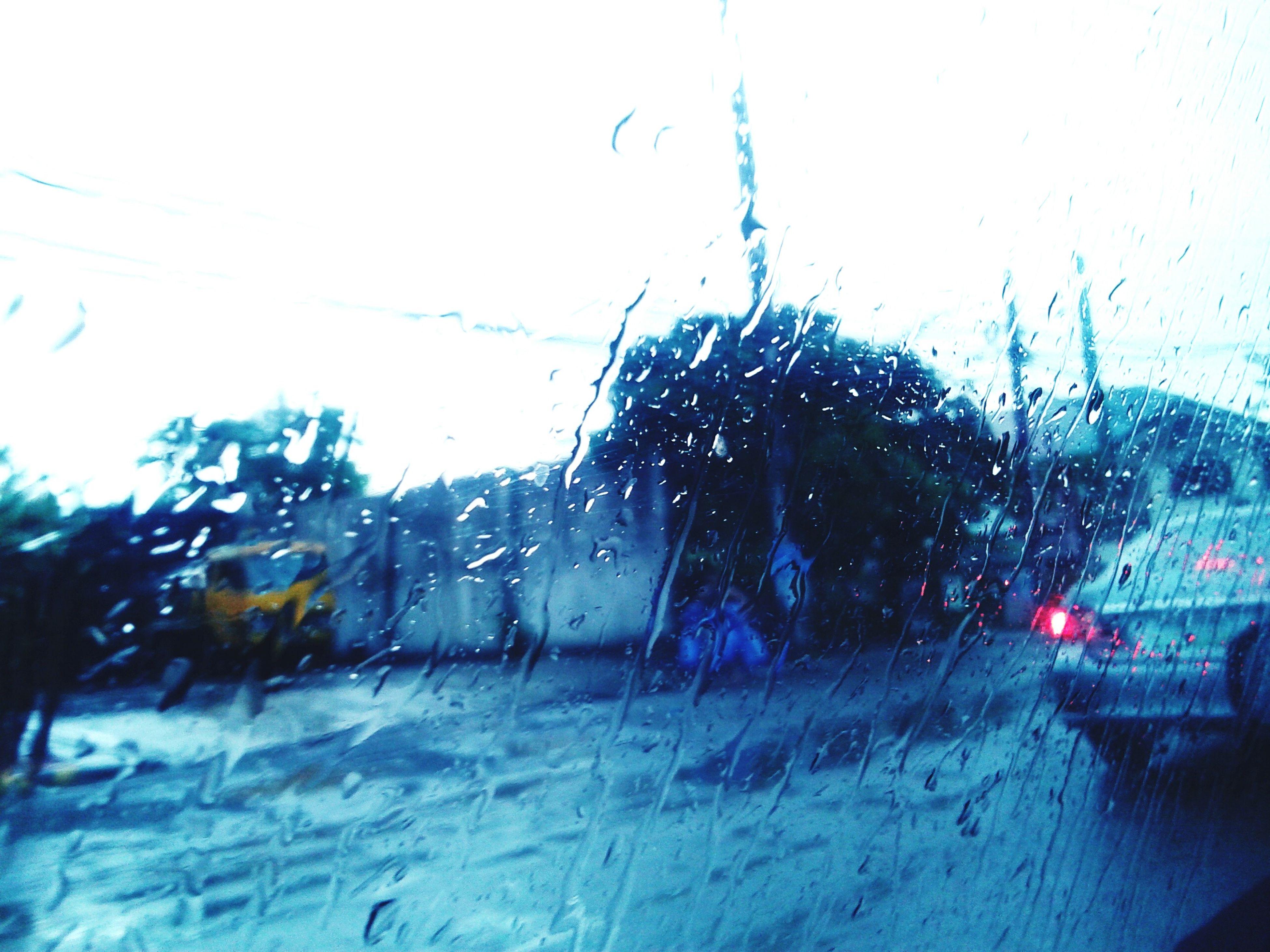 wet, drop, car, land vehicle, rain, window, transparent, season, transportation, glass - material, weather, mode of transport, raindrop, street, water, vehicle interior, windshield, monsoon, road, indoors