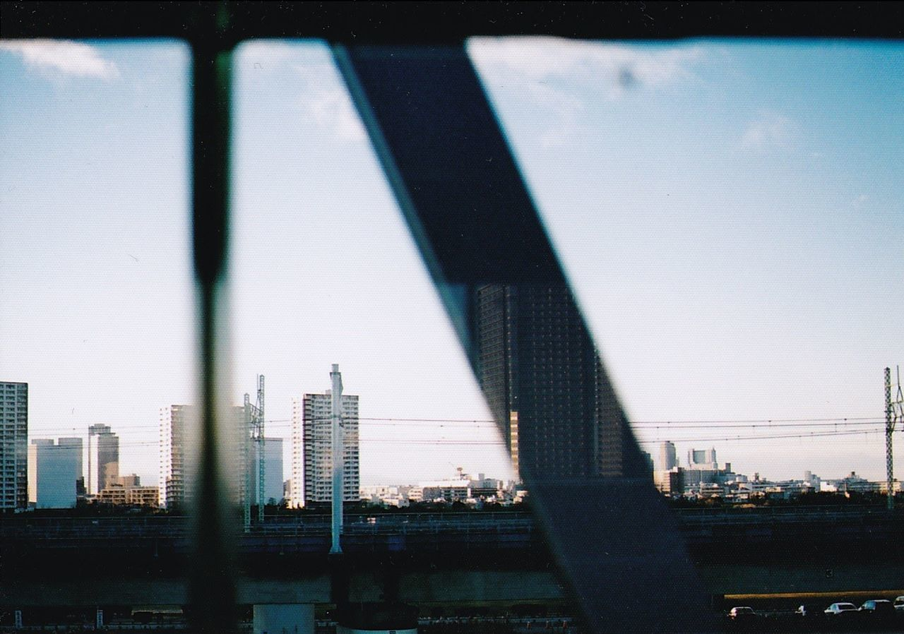 City Sky Skyscraper Urban Skyline Modern Day Outdoors No People Cityscape On The Train Train Window Built Structure GetbetterwithAlex EyeEm Best Shots EyeEm Japan EyeEm Gallery Film Film Photography