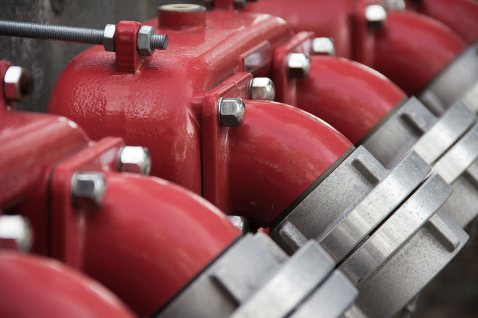 Detail of hydrants. Close-up Day Desaturated Detail Factory Fire Fighter Fire Hydrant Industry No People Red Solid Steel Visibility