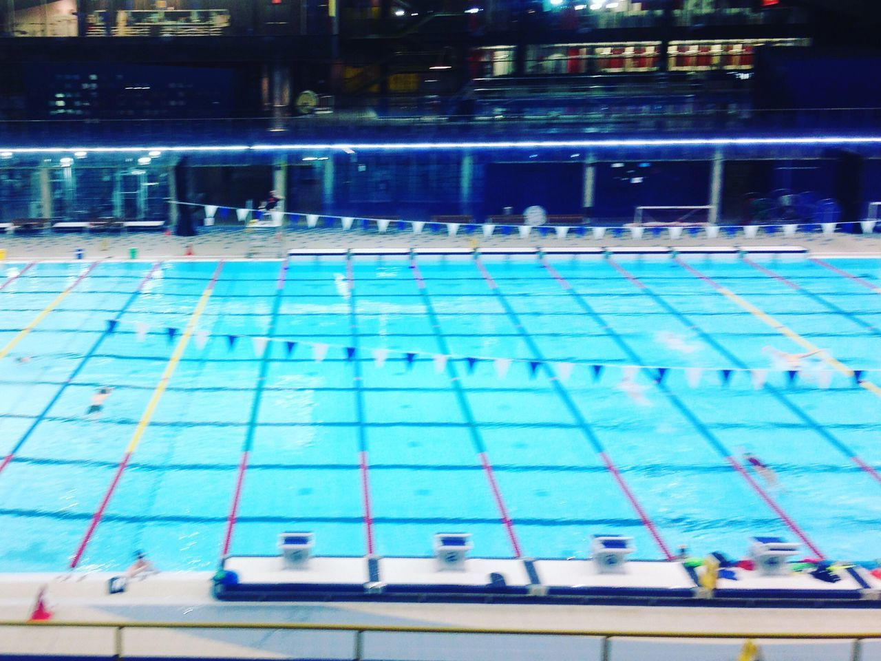 swimming pool, water, swimming lane marker, night, sport, indoors, illuminated, real people