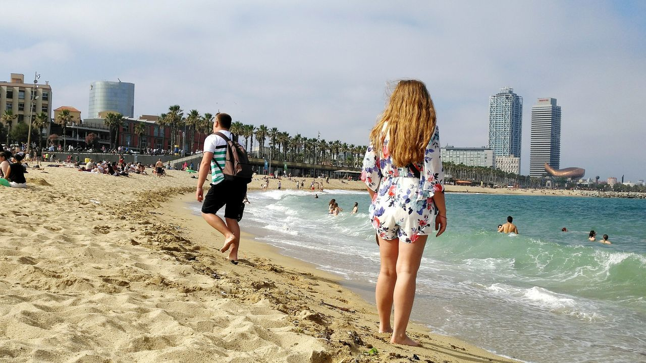 Beach Sand Vacations Two People Water City Skyscraper Sea Outdoors Leisure Activity Day Adult Women Motion Togetherness Sky Adults Only Urban Skyline People Full Length Barcelona♡♥♡♥♡ Architecture Sunlight Summer2017🌞 Cataluña Spain Live For The Story BYOPaper! The Great Outdoors - 2017 EyeEm Awards
