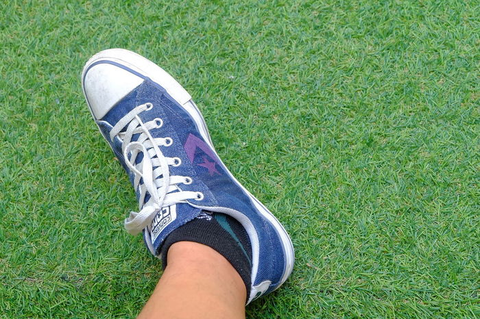 converse cons on greensward human legGrass Human Leg Green Color Human Foot Shoe Lifestyles Grass Green Sward Lawn Background Textured  Green Background Backgrounds Converse One Star Onestar Day Outdoors Nature Green Color Shoe Adults Only Adult High Angle View