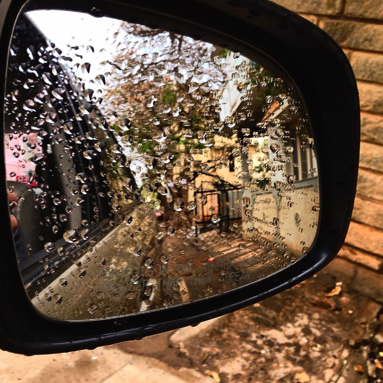 A wet Rear View Mirror. Car Droplets Drops Of Water Not Clear Rear View Mirror Rearview Reflection Shiny Smudged Water On Mir Wet Wetty