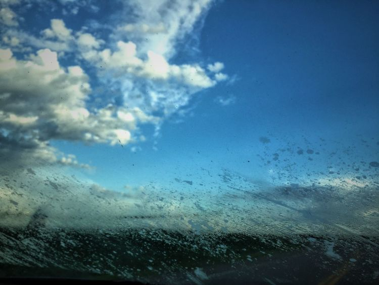 Sky Cloud - Sky Nature Weather Blue Water Wet No People Rain Day Outdoors Scenics Beauty In Nature Sea Close-up Airplane Wing