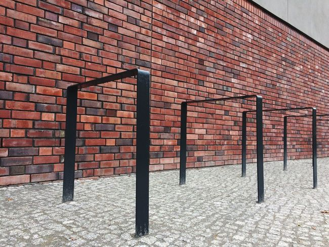 Brick Wall Built Structure Architecture No People Building Exterior Pattern day Bike Rack Urban Geometry Textures And Surfaces Wall - Building Feature Cobblestone Segments city lines red grey black Shapes