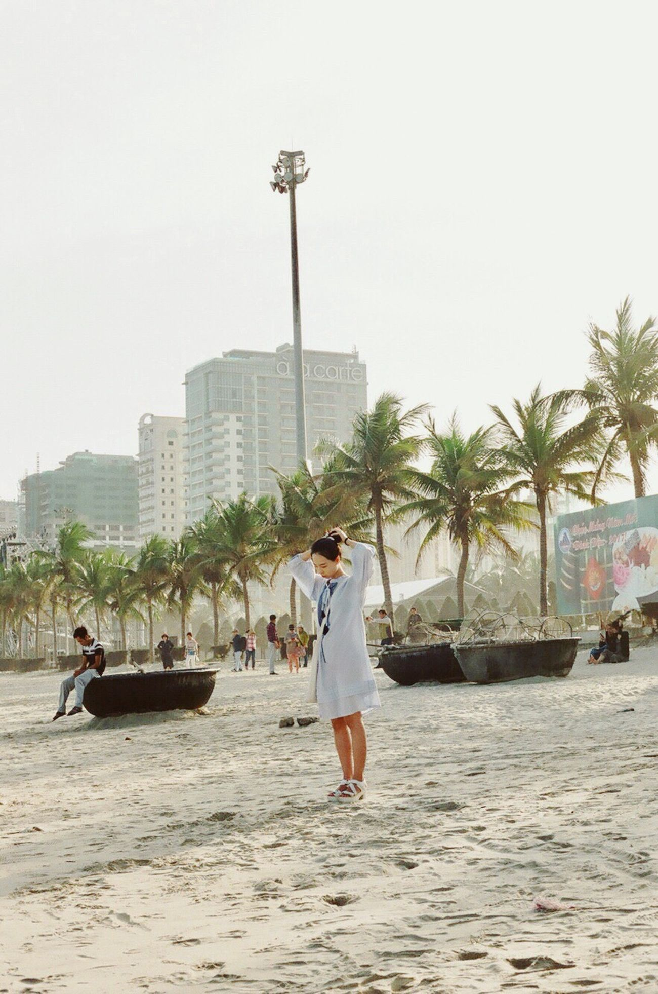 Filmisnotdead Filmphotography Holiday Light And Shadow Relaxing Beauty In Nature Palm Tree Vacations Beach Travel Destinations Outdoors City Women Capture The Moment Da Nang Mykhebeach Fashion Relaxing Time Nature Sand Sky Real People