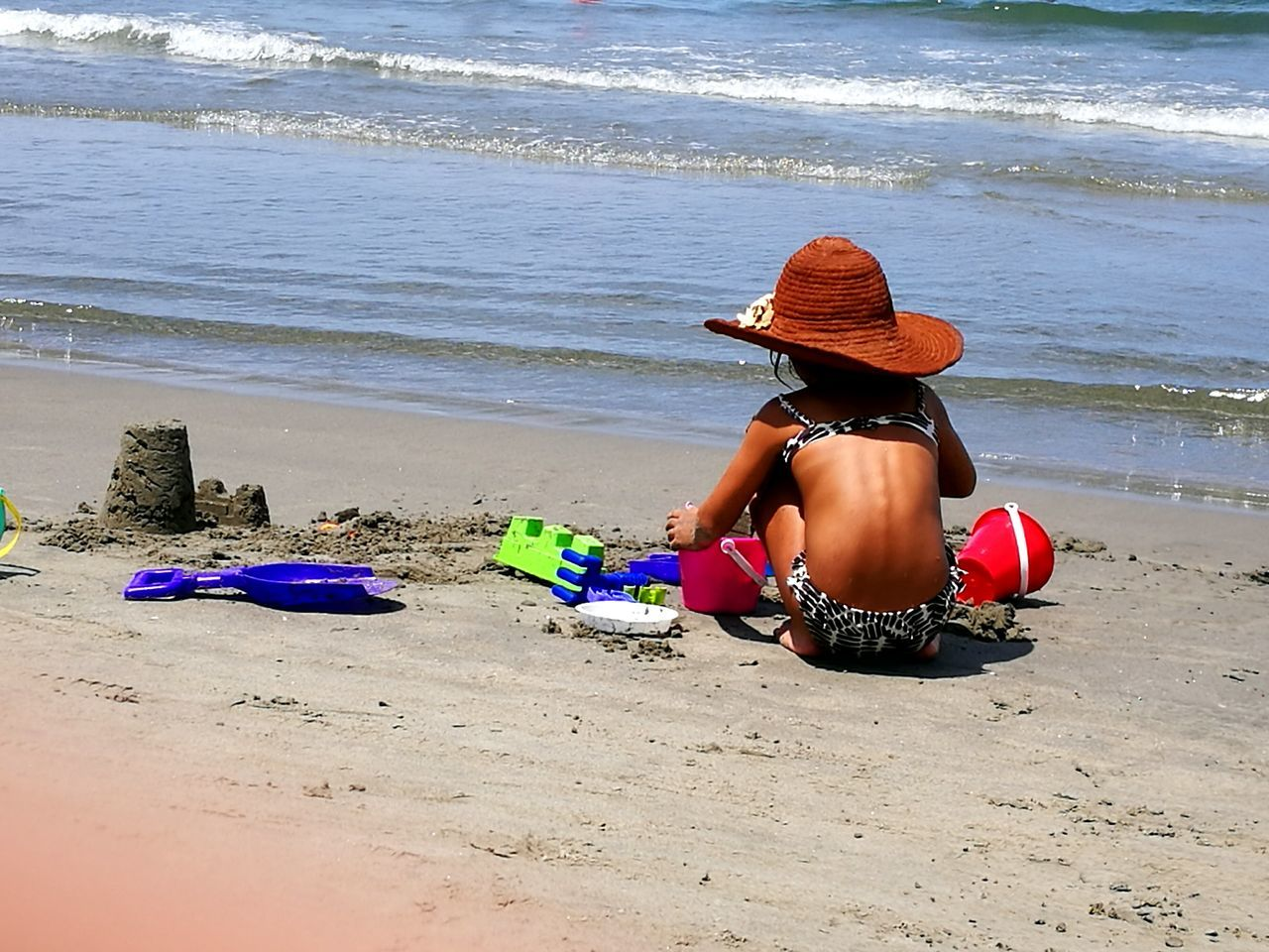 Beach Sand Sea Water Child One Person Outdoors Vacations Full Length Leisure Activity Childhood Day People Nature Adult Human Body Part Streetphotography Travel Photography Vacation City Street Travel Destinations Editorialphotography Cartagena, Colombia