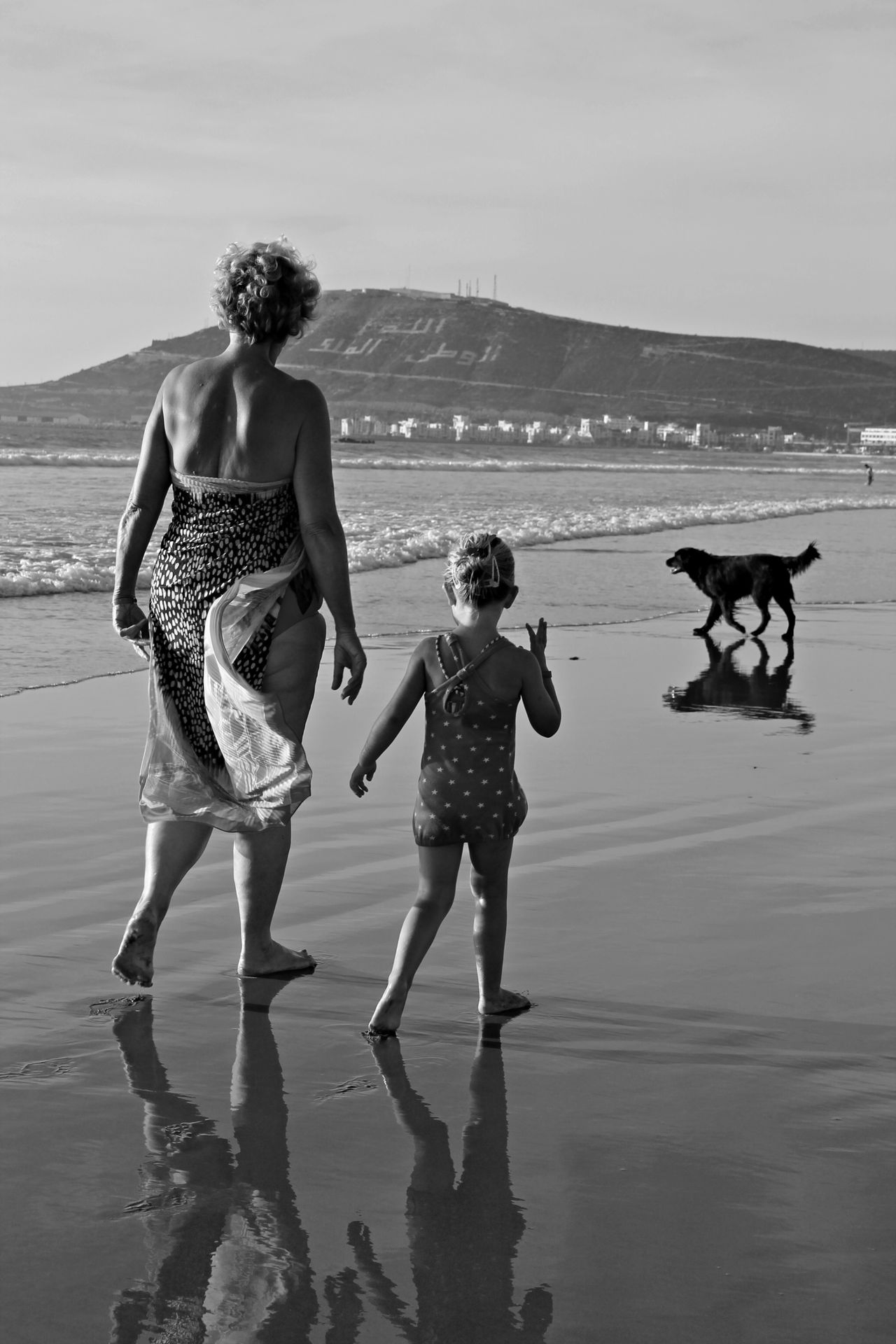 Mila and grandma... Quality time Agadir Morocco Blackandwhite Photography Casual Clothing Dog On Beach Escapism Friendship Front View Full Length Fun Granddaughter Grandmother Leisure Activity Lifestyles Morocco Portrait Real People Reflection Standing Three Quarter Length Togetherness Weekend Activities Women Young Adult Young Women