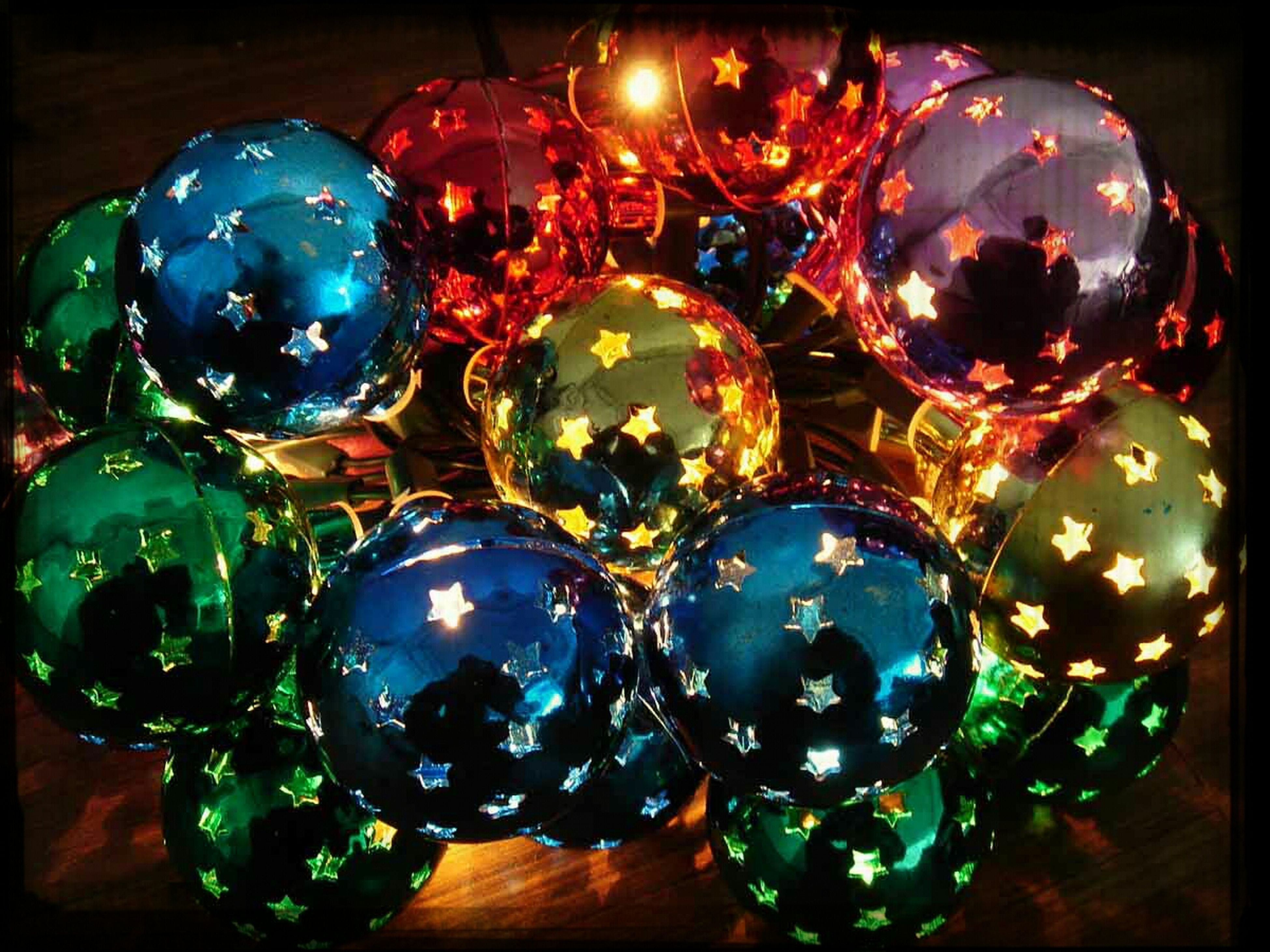 indoors, decoration, celebration, multi colored, illuminated, christmas, sphere, table, still life, christmas decoration, close-up, tradition, circle, decor, christmas ornament, hanging, glass - material, no people, christmas tree, lighting equipment