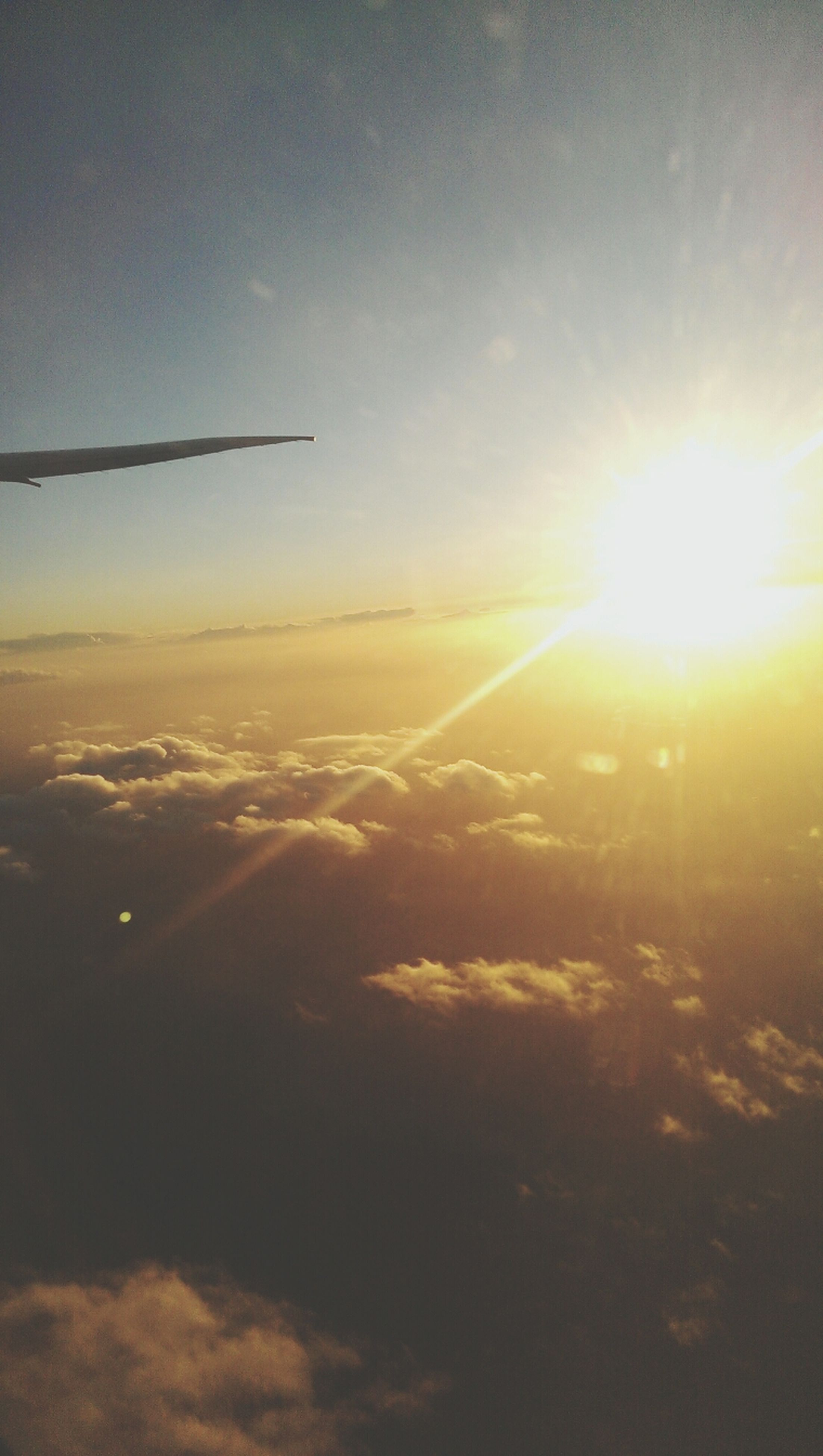 sun, sunset, scenics, sky, beauty in nature, sunbeam, sunlight, tranquil scene, tranquility, landscape, nature, flying, lens flare, idyllic, cloud - sky, orange color, bright, outdoors, airplane, aerial view