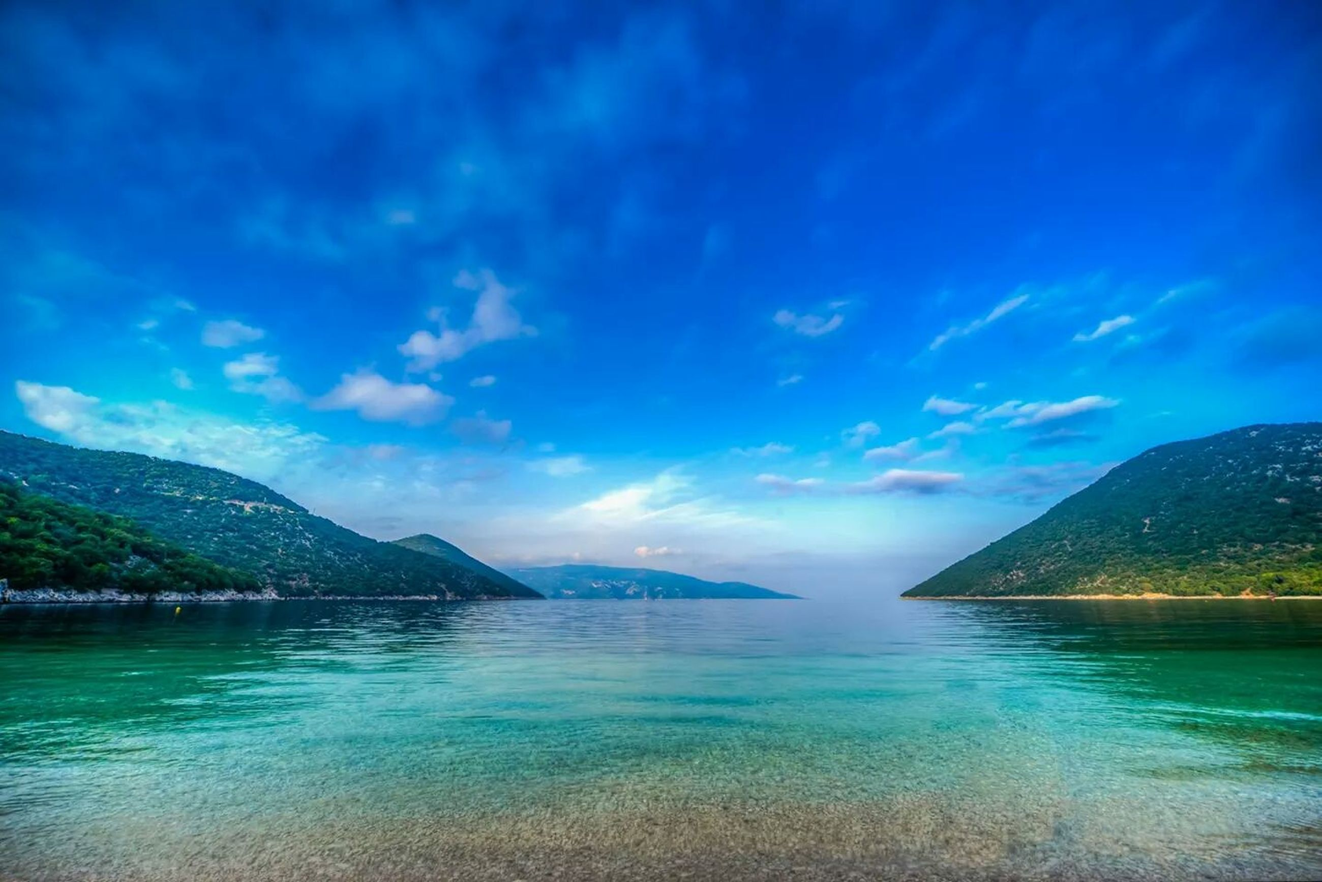 water, tranquil scene, scenics, mountain, tranquility, blue, beauty in nature, sky, sea, nature, mountain range, lake, waterfront, idyllic, cloud - sky, cloud, calm, reflection, non-urban scene, outdoors