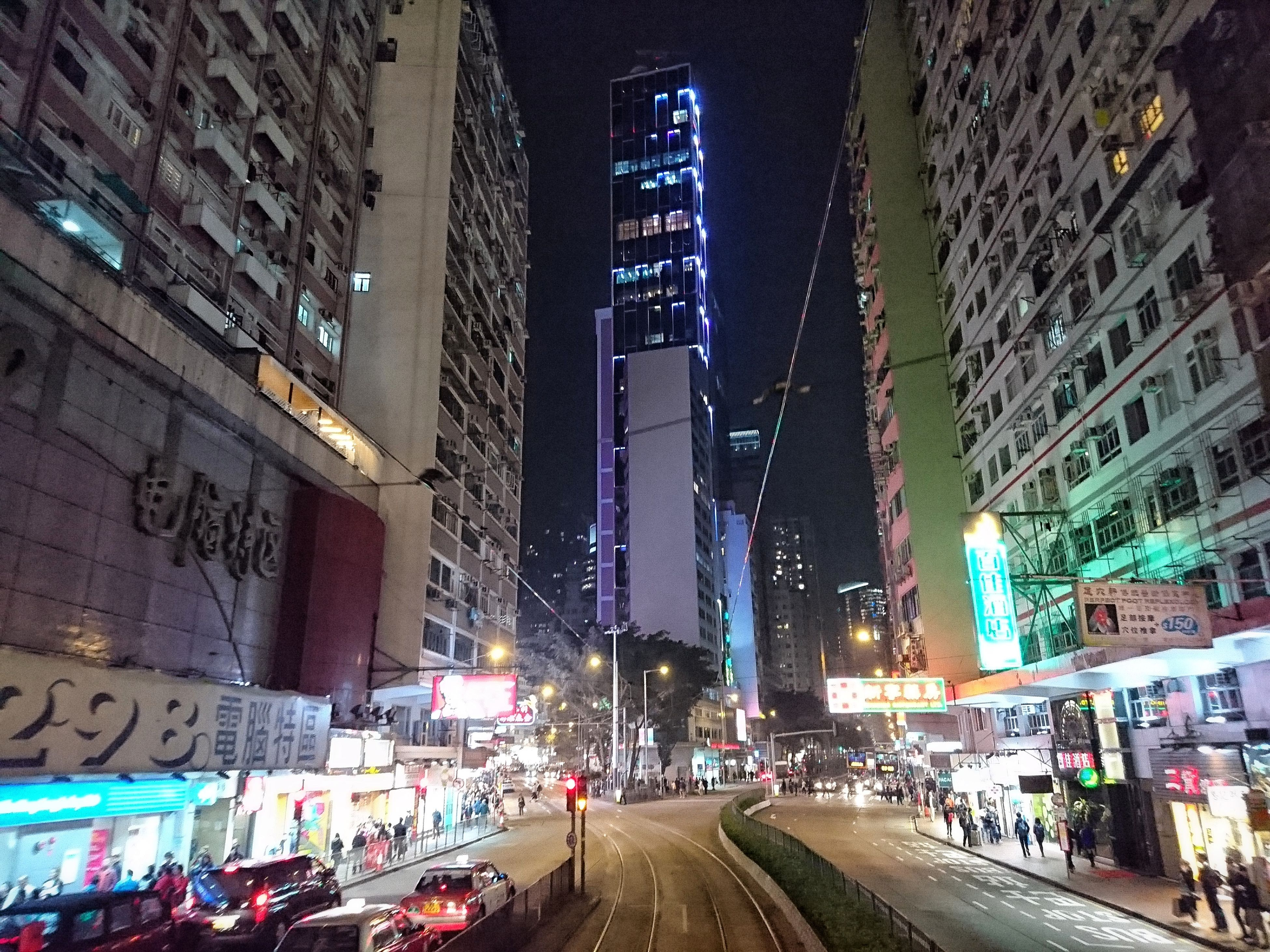 architecture, illuminated, building exterior, night, built structure, city, skyscraper, modern, transportation, street, road, travel destinations, city life, communication, real people, outdoors