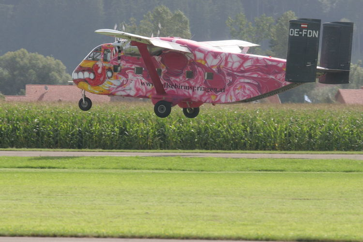 Airplane Day Grass Mode Of Transport No People Old-fashioned Outdoors Pink Skyvan Take Off Transportation