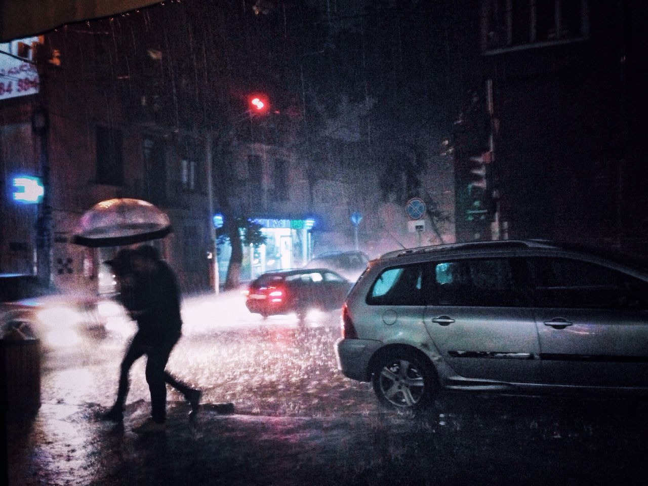 Rain Night Car Weather Wet Street Rainy Season City City Life Protection Illuminated Walking Real People Transportation RainDrop Full Length Land Vehicle Rear View Outdoors