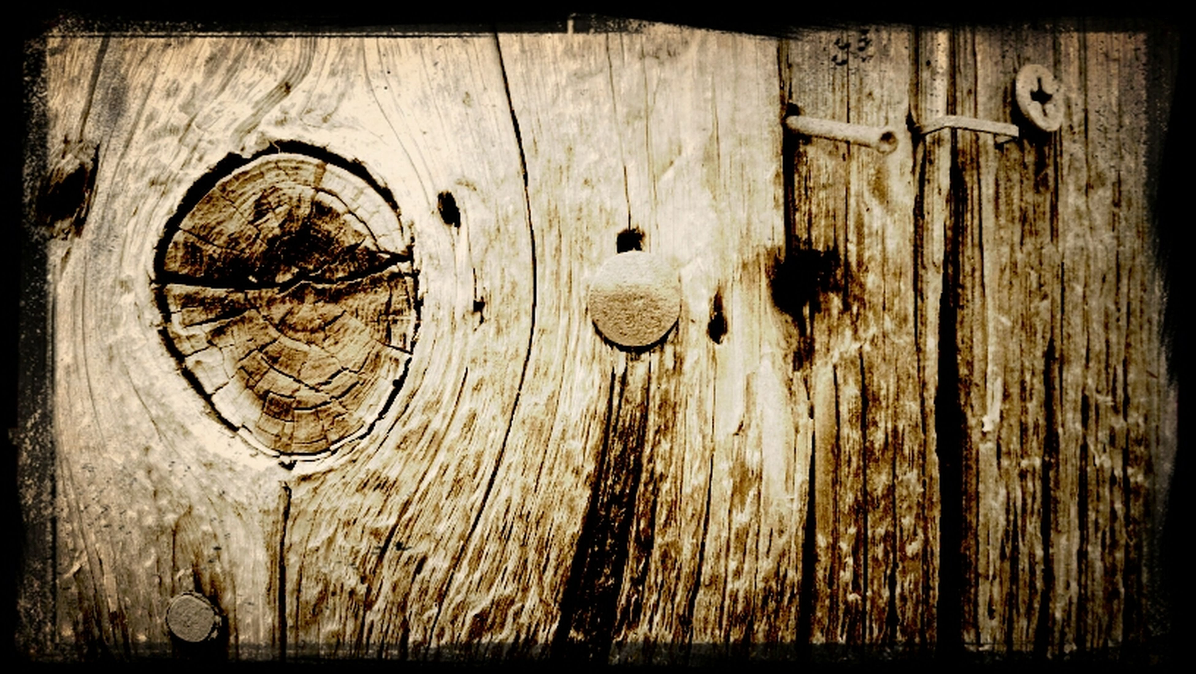 wood - material, transfer print, wooden, wood, auto post production filter, close-up, full frame, old, textured, backgrounds, plank, door, weathered, pattern, circle, no people, metal, outdoors, day, wall - building feature