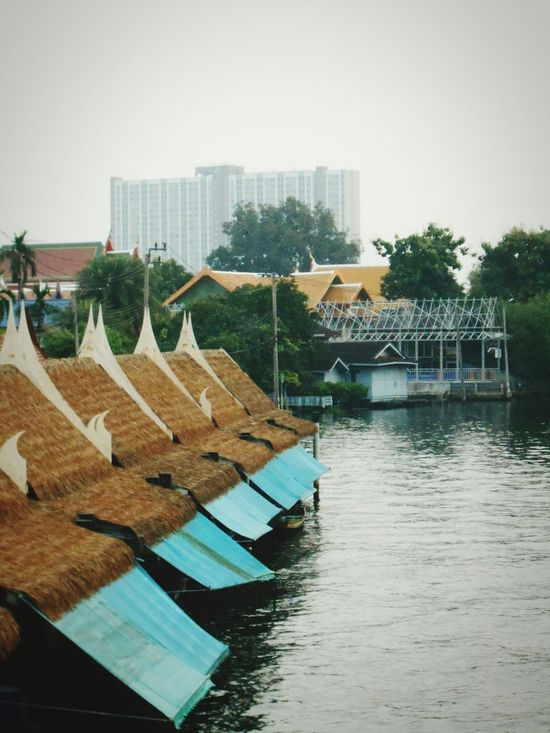 Canal view: Taling Chan Floating Market Built Structure Waterfront Roof Elevated View Rooftop ,Taling Chan Thailand. .