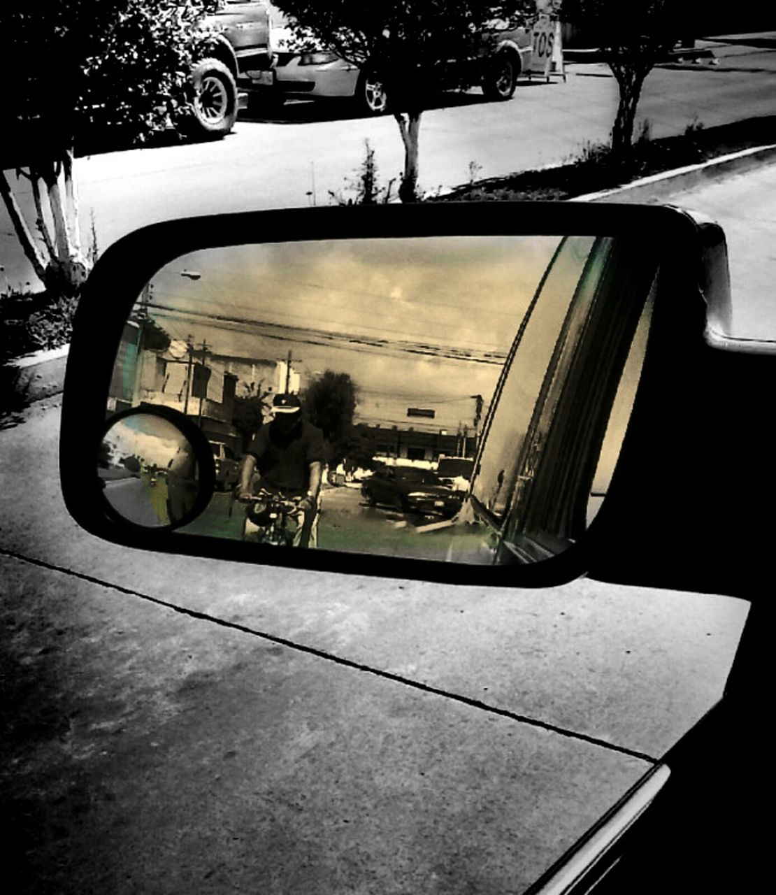 car, transportation, window, side-view mirror, land vehicle, mode of transport, reflection, day, real people, tree, indoors, city, architecture, sky, close-up