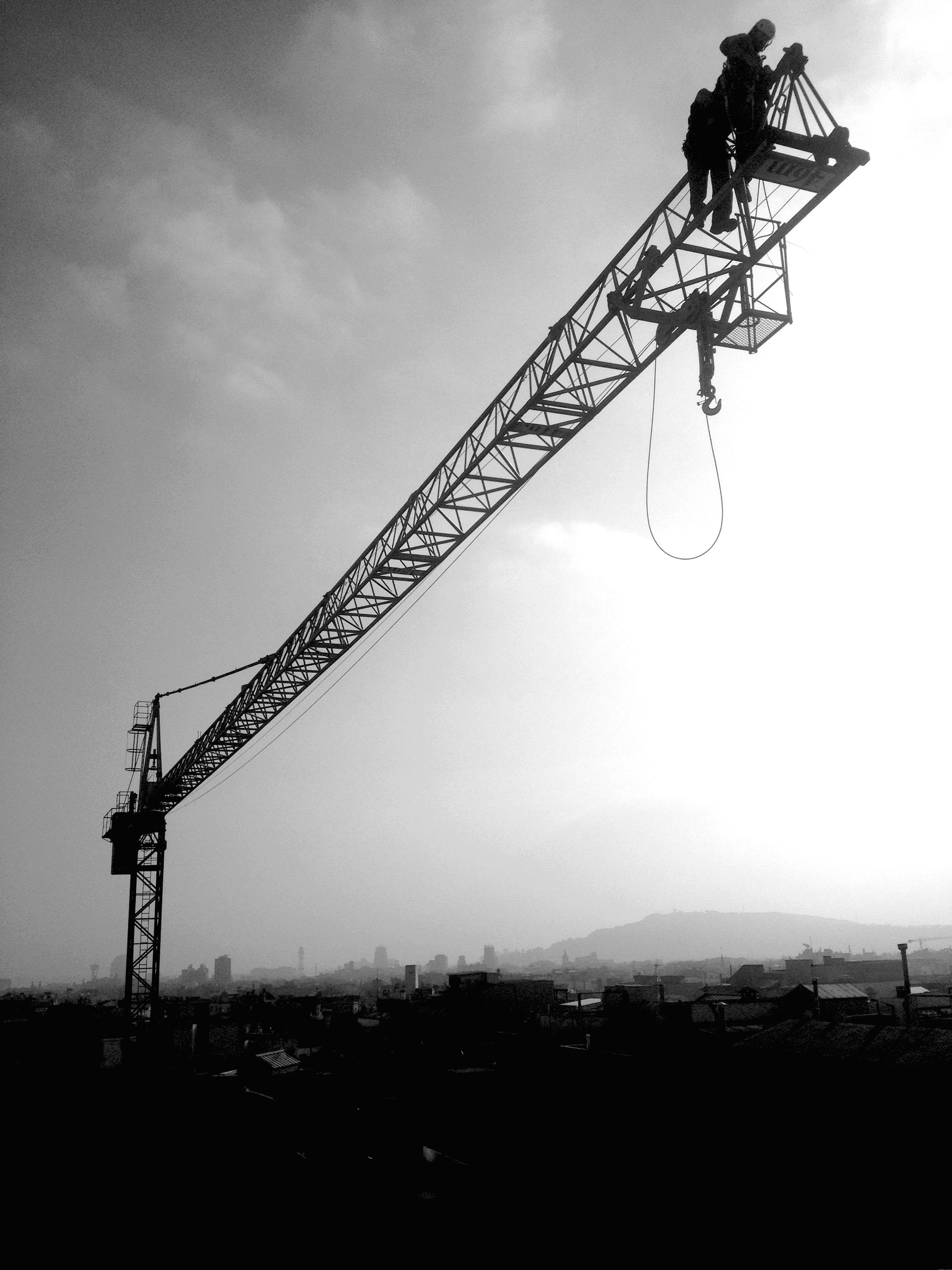 crane - construction machinery, sky, silhouette, construction site, low angle view, development, metal, crane, dusk, sunset, construction, technology, outdoors, construction industry, no people, nature, connection, cloud - sky, electricity, fuel and power generation