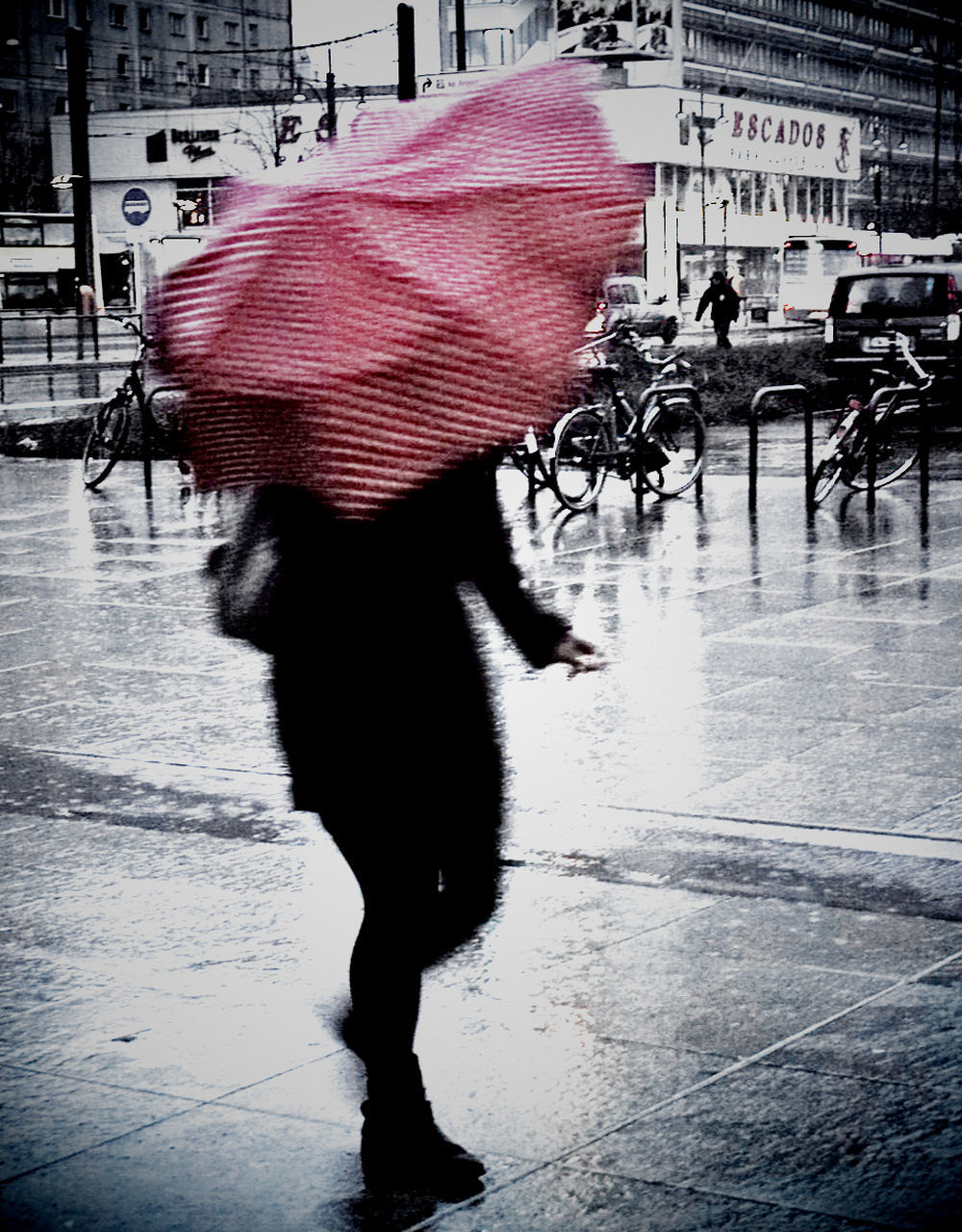 Woman With Umbrella Walking On Street In City During Monsoon