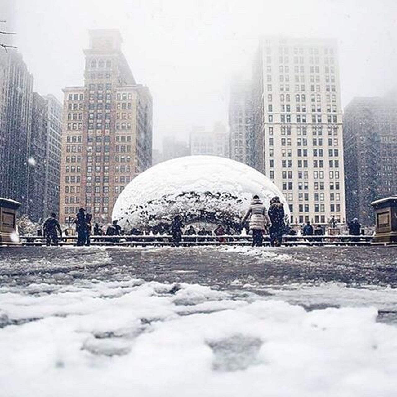 city, architecture, building exterior, built structure, skyscraper, weather, city life, winter, outdoors, urban skyline, cityscape, modern, day, snow, snowing, people, sky, adult