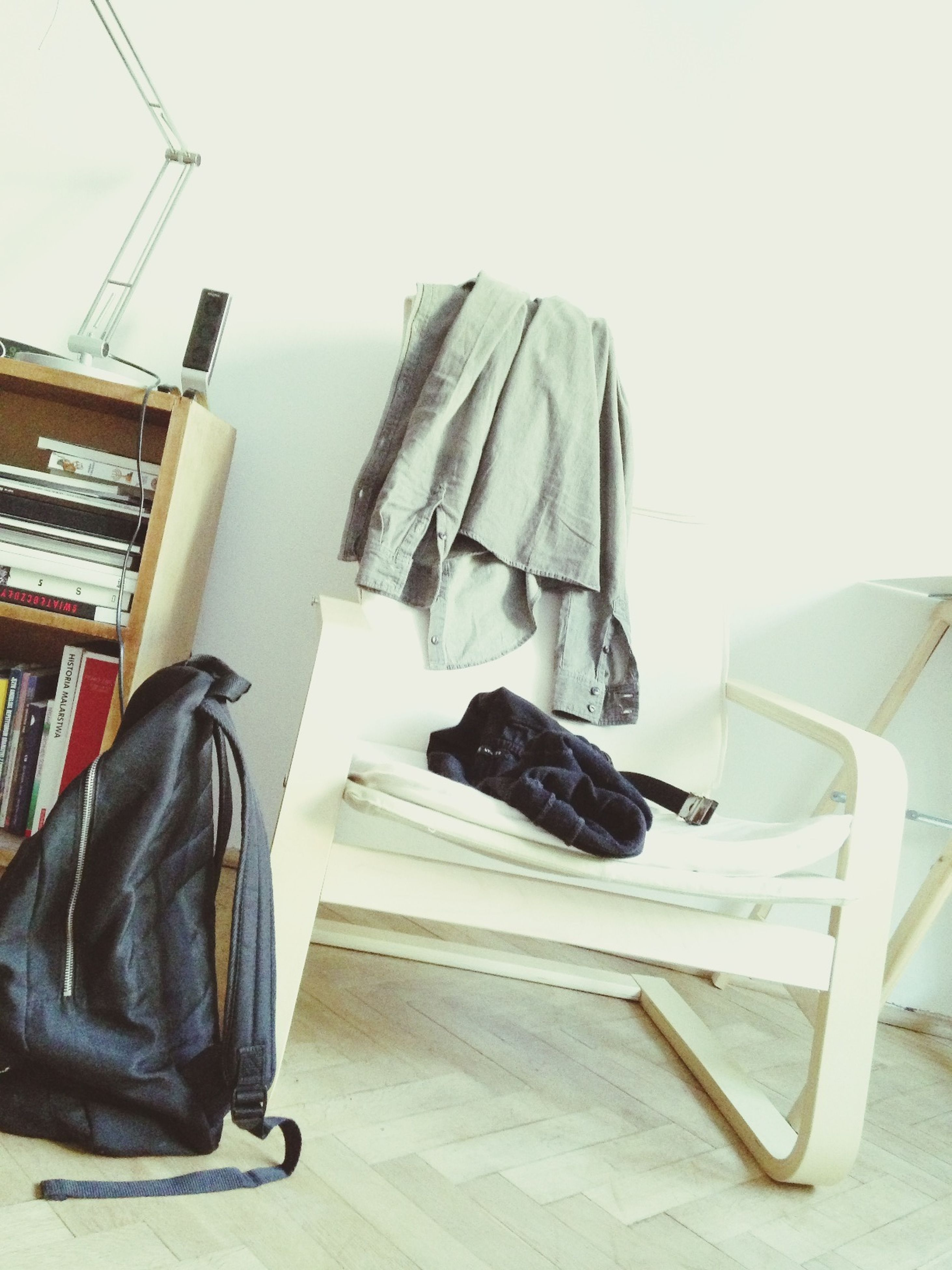 low angle view, no people, day, indoors, chair, metal, hanging, shoe, close-up, wood - material, still life, equipment, in a row, sunlight, part of, white color, clear sky, railing, absence