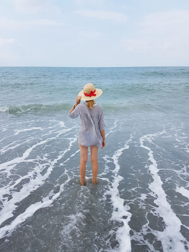 Full Length Sea Beauty In Nature Nature Woman Blue Wave Freedom Serenity Vacation Beachtime Beachfashion Water One Person Beach Outdoors Horizon Over Water Adult Day Sky EyeEmNewHere Horizon Over Sea Looking At The Horizon Solitude And Silence In The Sea In The Water Long Goodbye Live For The Story