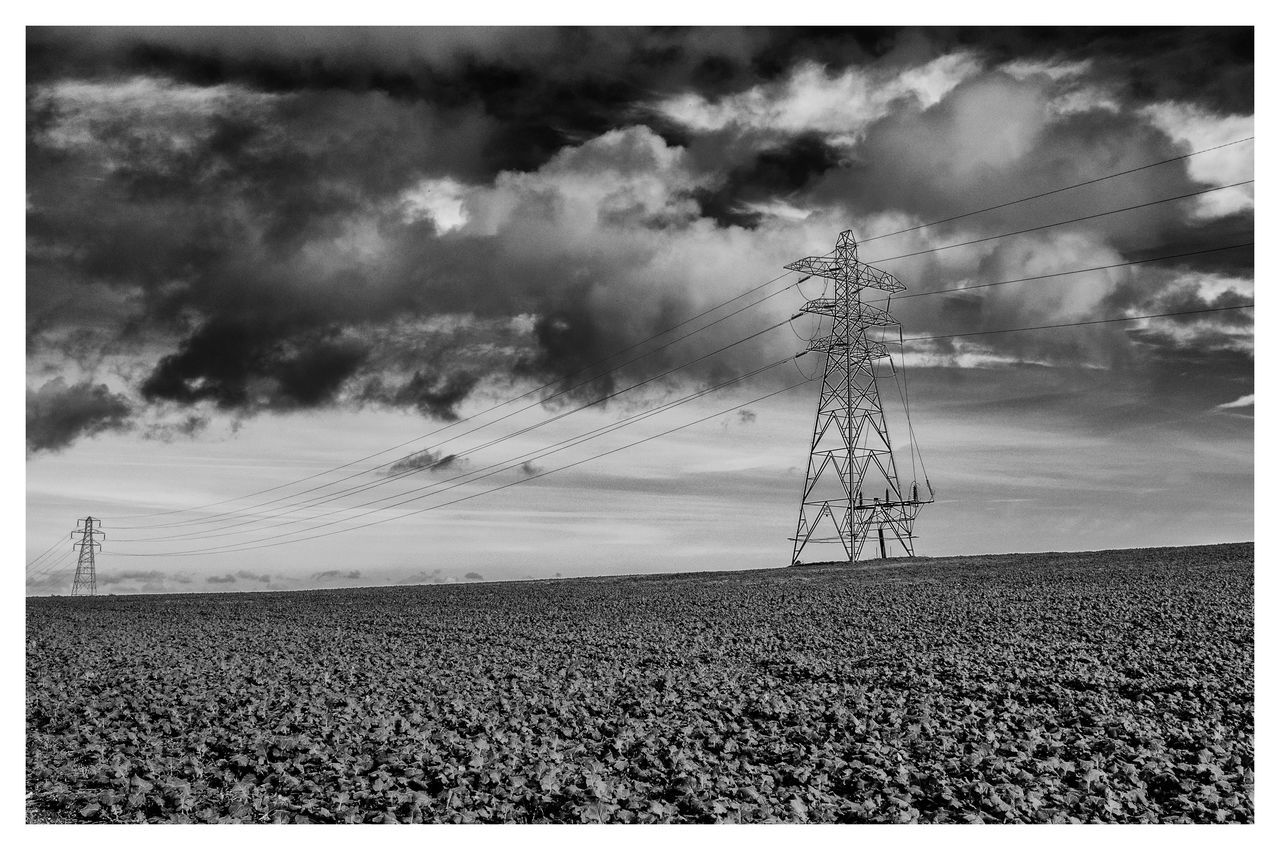 Electricity Pylons In Agricultural Field