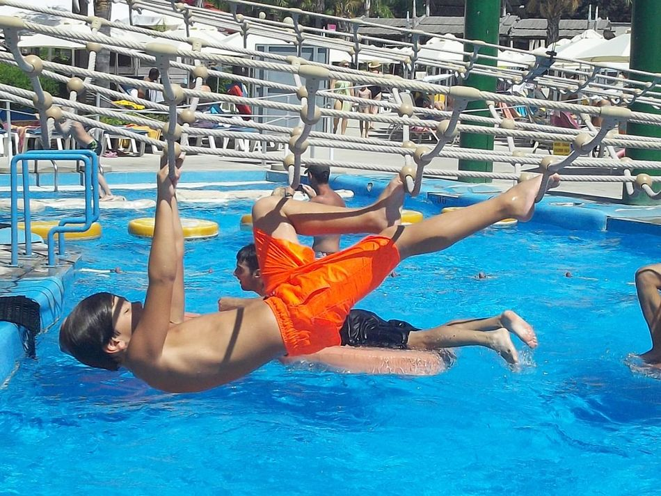 Blue Blue & Orange Boys Activity Boys Excercise Boys Su Boys Swi Day Enjoyment Fun Leisure Activity Lifestyles Nature Orange Swimming Shorts Outdoors Poolside Relaxation Rippled Summer Summer Excercise Not A Swimming Pool Tourism Turquoise Colored Vacations Water Water Park