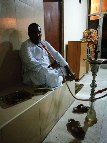 One Man Only One Person Sitting Indoors  Real People Indoors  Arabic Tradition Arabs Arabic Culture Smoking Shisha Sitting Pretty Sitting Comfortably