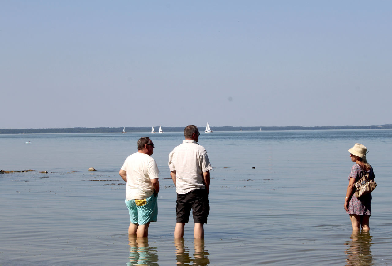 three persons at a sea Baden Blau Blue Calm Friendship Fun Hat Holidays Maurenrock Nature Outdoors Poland Polenta Rear View Reflections Sea See Sky Sommer Standing Stille Summer Travel Vacations Water